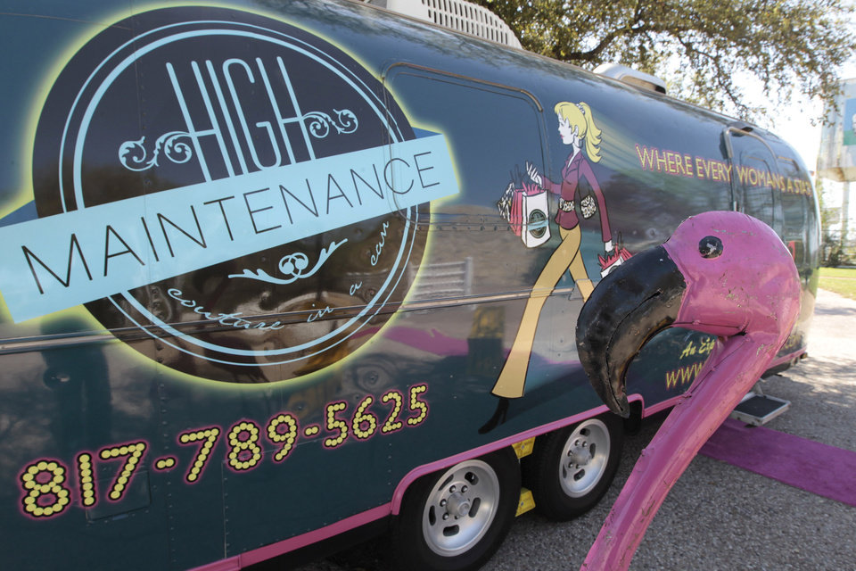 Photo - Rosie Dalton and Sande Brandt have started their boutique on wheels, Couture in a Can, in a specially outfitted Airstream travel trailer, March 11, 2013, in Fort Worth, Texas. (Ron T. Ennis/Fort Worth Star-Telegram/MCT)
