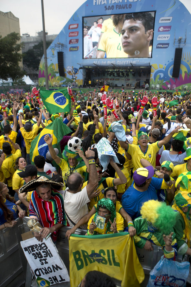 Photo - Fans wait for the start of the Mexico vs. Brazil match at the FIFA Fan Fest during the 2014 soccer World Cup in Sao Paulo, Brazil, Tuesday, June 17, 2014.  (AP Photo/Dario Lopez-Mills)