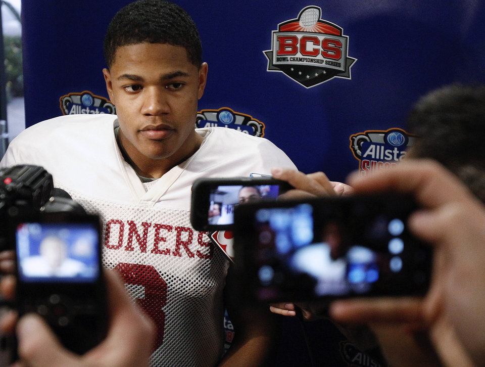 Oklahoma wide receiver Sterling Shepard (3) talks with the media at the conclusion of practice at the New Orleans Saints' practice facility in Metairie, La., Saturday, Dec. 28, 2013. Oklahoma will play Alabama in the Sugar Bowl NCAA college football game on Jan. 2. (AP Photo/Bill Haber)