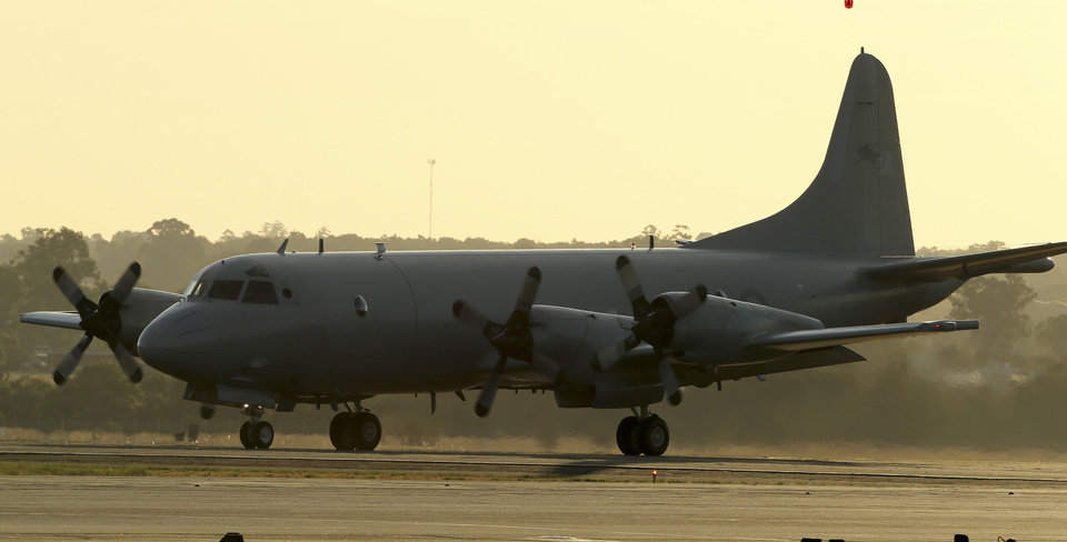 Photo - A Royal Australian Air Force P-3 Orion taxies along the tarmac at RAAF Base Pearce as it arrives back from the on-going search operations for missing Malaysia Airlines Flight MH370 in Perth, Australia, Tuesday, April 8, 2014. Search crews have failed to relocate faint sounds heard deep in the Indian Ocean, possibly from the missing Malaysian jetliner's black boxes whose batteries are at the end of their life. (AP Photo/Rob Griffith)