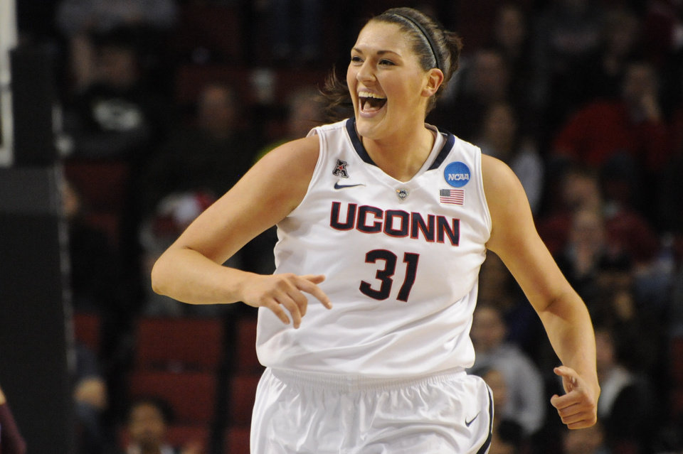Photo - Connecticut's Stefanie Dolson (31) during the first half of their Monday March 31, 2014, regional final against Texas A&M in the NCAA college basketball tournament in Lincoln, Neb.(AP Photo/Dave Weaver)