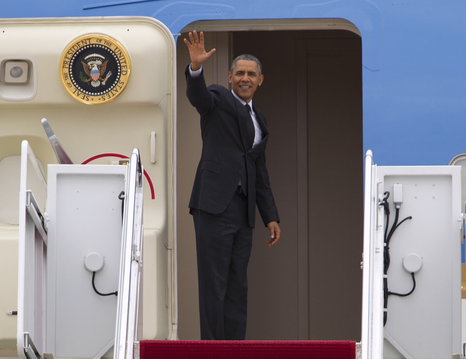 Photo - President Barack Obama waves from Air Force One before departing at Andrews Air Force Base, Md., on Wednesday, May 7, 2014. Obama is heading to Arkansas where he will meet with first responders and families affected by the recent tornados. The president will make the stop while on his way to California, where he will raise money for the Democratic Party and receive an award from a foundation created by movie director Steven Spielberg.( AP Photo/Jose Luis Magana)
