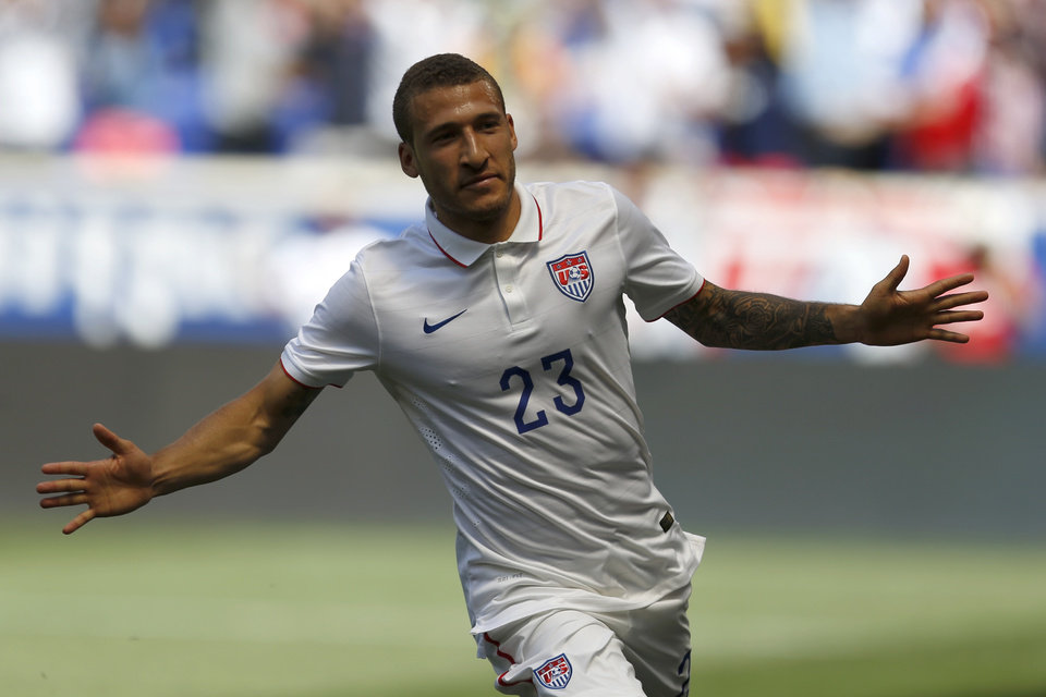 Photo - United States' Fabian Johnson celebrates after scoring a goal against Turkey in the first half of an international friendly soccer match on Sunday, June 1, 2014, in Harrison, N.J. (AP Photo/Julio Cortez)