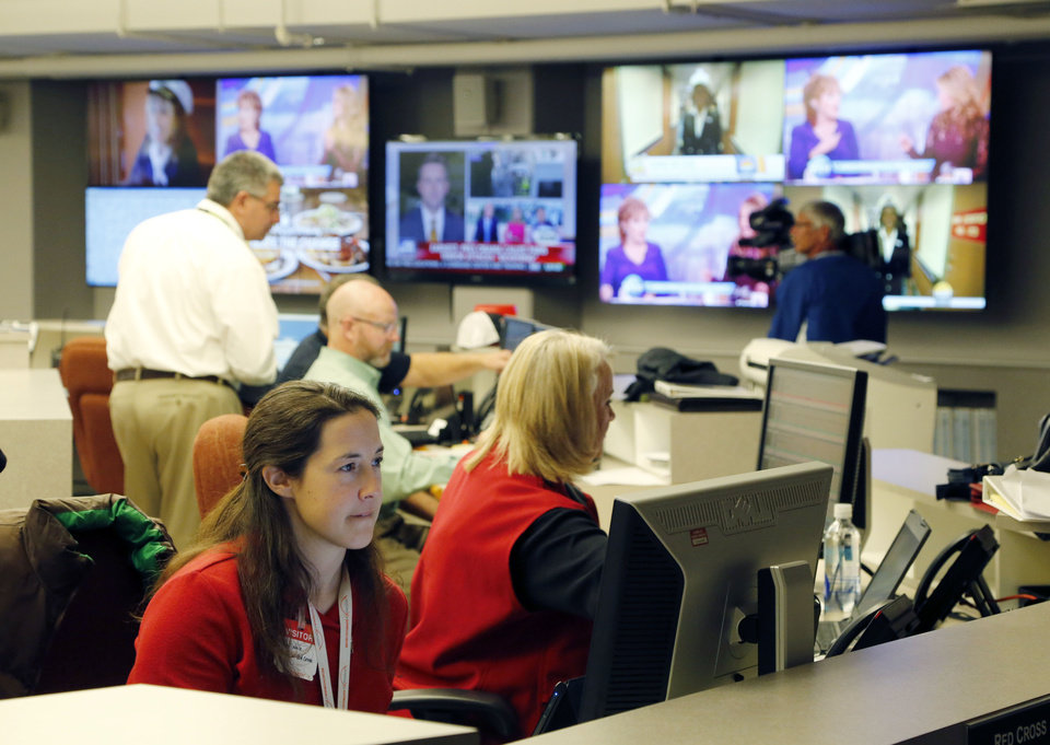 Photo -  State and local emergency managers participate in a statewide drill at the State Emergency Operations Center in Oklahoma City. [Paul Hellstern, The Oklahoman]