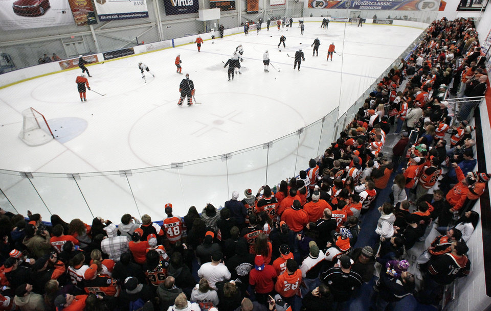 A capacity crowd of Philadelphia Flyers fans fills the rink to capacity at the first practice session at the team's training camp Sunday, Jan. 13, 2013, in Voorhees, NJ. The Flyers, and other NHL teams, returned after a 113-day lockout ended with an settlement on a new collective bargaining agreement. (AP Photo/Tom Mihalek)