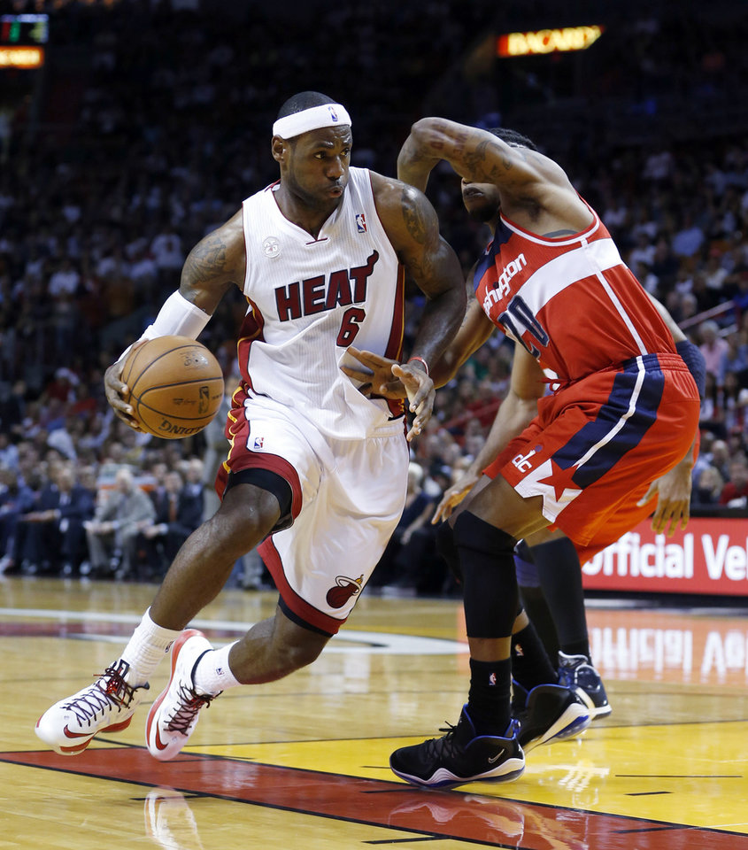 Miami Heat's LeBron James (6) drives against Washington Wizards' Cartier Martin during the second half of an NBA basketball game in Miami, Sunday, Jan. 6, 2013. The Heat won 99-71. (AP Photo/Alan Diaz)