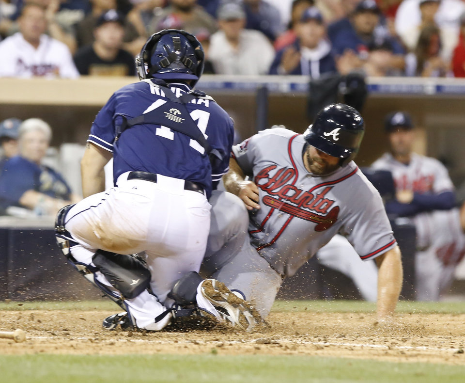 Photo - San Diego Padres catcher Rene Rivera makes the out at home on Atlanta Braves's Evan Grattis during the eighth inning of a baseball game Saturday, Aug. 2, 2014, in San Diego. (AP Photo/Don Boomer)