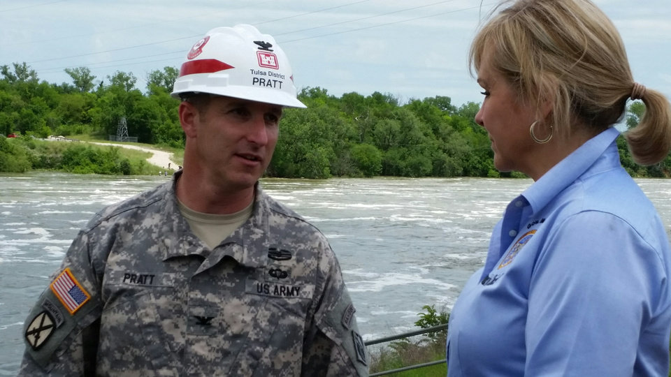 Photo - Army Col. Richard Pratt, district engineer for the Tulsa District of the U.S. Army Corps of Engineers, discusses with Gov. Mary Fallin on Wednesday how recent rains have caused flooding at Lake Texoma.  Photo provided by governor's office