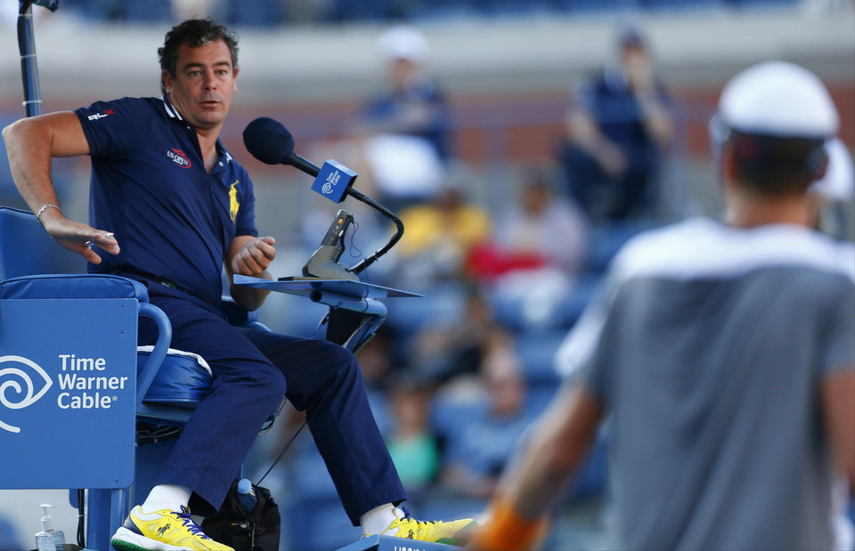 Photo - The chair umpire explains a decision to Tomas Berdych, of the Czech Republic, during a second round match against Martin Klizan of Slovakia during the 2014 U.S. Open tennis tournament, Friday, Aug. 29, 2014, in New York. (AP Photo/Matt Rourke)