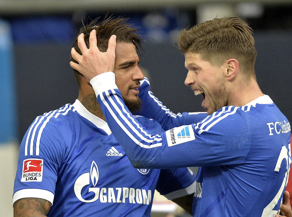 Photo - Schalke's Klaas-Jan Huntelaar of the Netherlands, right, celebrates Schalke's Kevin-Prince Boateng of Ghana after the opening goal  during the German Bundesliga soccer match between FC Schalke 04 and VfL Wolfsburg in Gelsenkirchen,  Germany, Saturday, Feb. 1, 2014. (AP Photo/Martin Meissner)