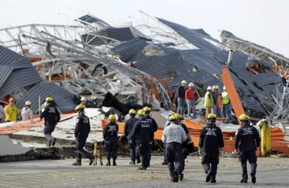 Members of Missouri Task Force One search-and-rescue team work at a tornado-damaged Home Depot store Tuesday, May 24, 2011, in Joplin , Mo. A large tornado moved through much of the city Sunday, damaging a hospital and hundreds of homes and businesses. (AP Photo/Jeff Roberson)