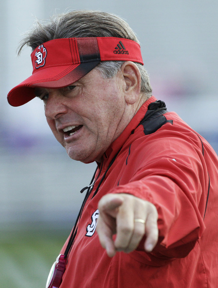 Photo -   South Dakota coach Joe Glenn points as he shouts to his team during the second half of an NCAA college football game against Northwestern in Evanston, Ill., Saturday, Sept. 22, 2012. (AP Photo/Nam Y. Huh)