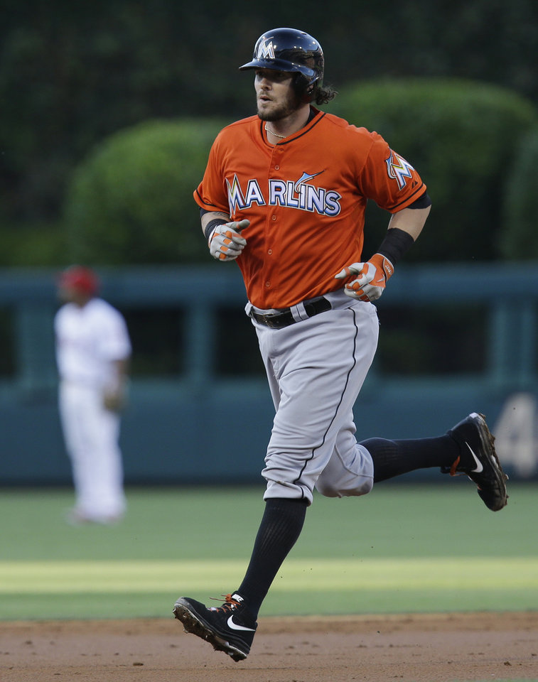Photo - Miami Marlins' Jarrod Saltalamacchia rounds the bases after hitting a home run in the third inning of a baseball game against the Philadelphia Phillies, Thursday, June 26, 2014, in Philadelphia. (AP Photo/Laurence Kesterson)