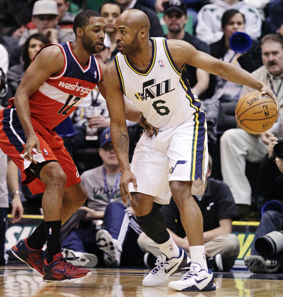 Photo - Washington Wizards' A.J. Price (12) defends against Utah Jazz's Jamaal Tinsley (6) during the first quarter of an NBA basketball game, Wednesday, Jan. 23, 2013, in Salt Lake City. (AP Photo/Rick Bowmer)