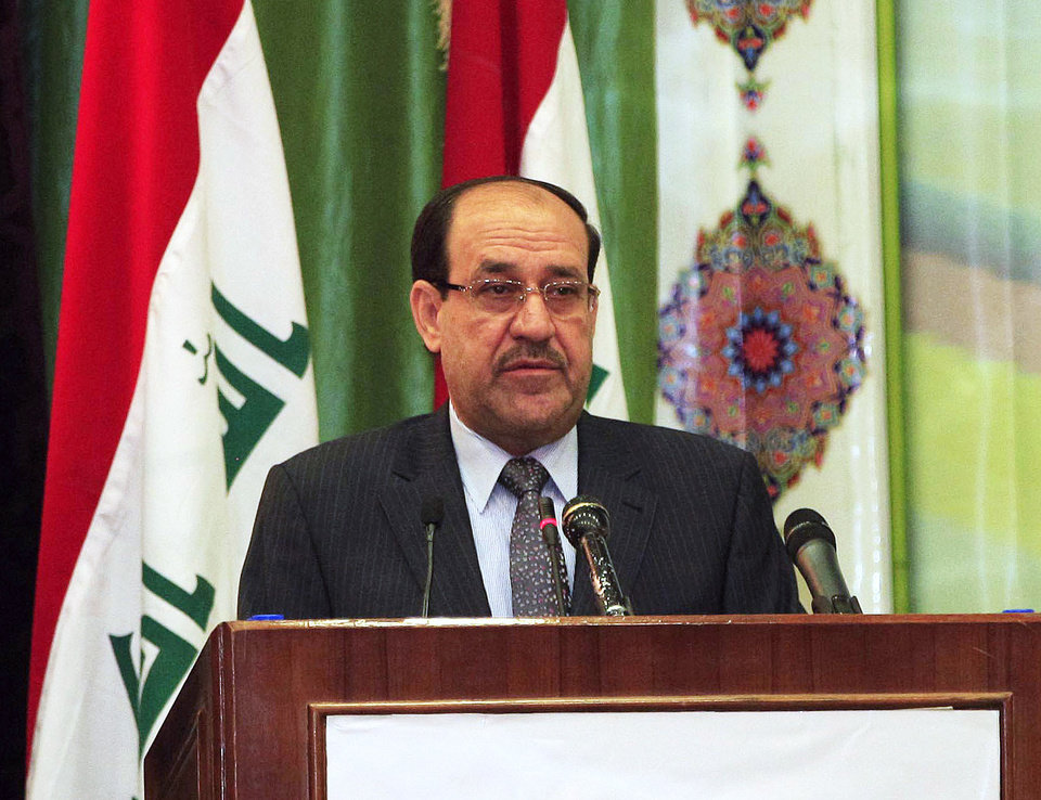 Photo - Iraqi Prime Minister Nouri al-Maliki speaks during Convergence of religions conference in Baghdad, Iraq, Saturday, April 27, 2013. Gunmen killed 10 people in Iraq, including five soldiers near the main Sunni protest camp west of Baghdad, the latest in a wave of violence that has raised fears the country faces a new round of sectarian bloodshed. The attack on the army intelligence soldiers in the former insurgent stronghold of Ramadi drew a quick response from al-Maliki, whose Shiite-led government has been the target of rising Sunni anger over perceived mistreatment.(AP Photo/Karim Kadim)