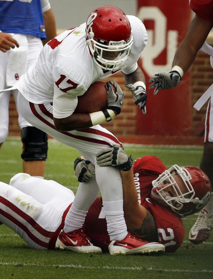 Trey Metoyer (17) is stopped by Tom Wort (21) during the University of Oklahoma (OU) football team's annual Red and White Game at Gaylord Family/Oklahoma Memorial Stadium on Saturday, April 14, 2012, in Norman, Okla.  Photo by Steve Sisney, The Oklahoman