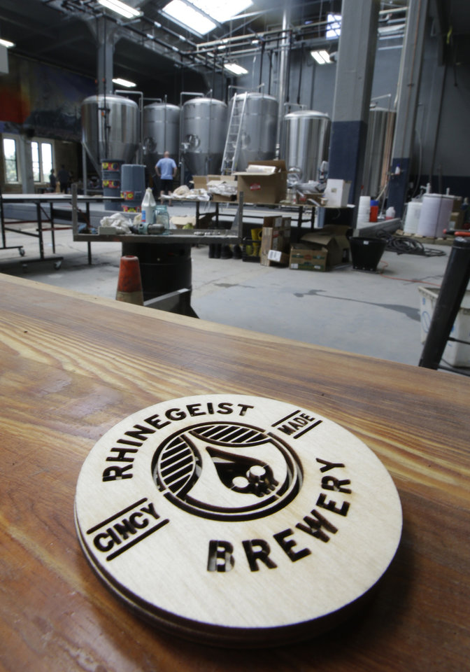 Photo - A stack of coasters sit on a table, Wednesday, June 19, 2013, in Cincinnati, inside the Rhinegeist brewery.  The tapoom  is set to open to the public June 29 in what used to be part of the old Christian Moerlein complex. (AP Photo/Al Behrman)