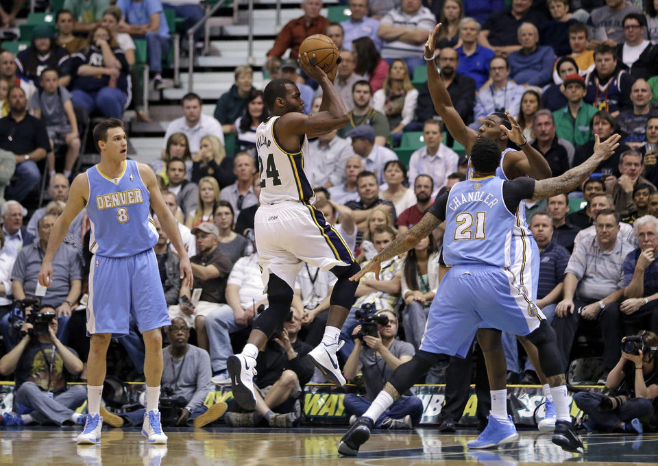 Utah Jazz's Paul Millsap (24) shoots as Denver Nuggets' Kenneth Faried, back right, Danilo Gallinari (8) and Wilson Chandler (21) look on in the second quarter during an NBA basketball game on Wednesday, April 3, 2013, in Salt Lake City. (AP Photo/Rick Bowmer)