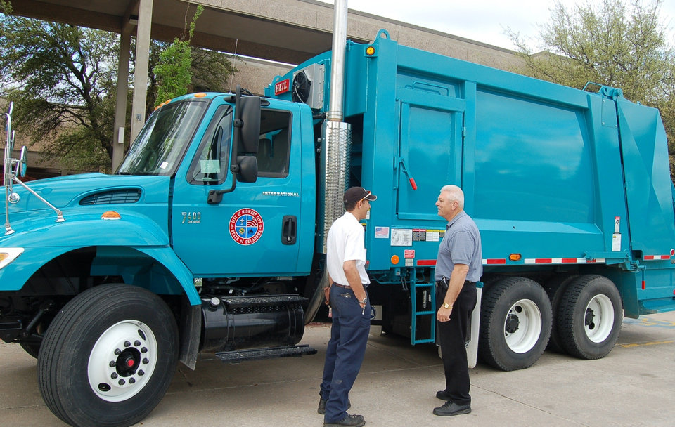 MWC's new Refuge Sanitation Truck.  Shown in photo: Keith Johnson, Residental Routing Coordinator; City Councilman Jim Ray.<br/><b>Community Photo By:</b> Kay Hunt<br/><b>Submitted By:</b> Kay, Midwest City
