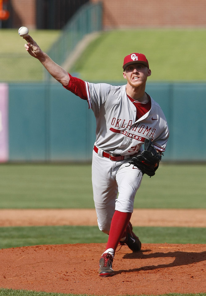 Photo - Oklahoma starting pitcherJake Elliott pitches in the first inning of a first-round game against Oklahoma State in the Big 12 conference NCAA college baseball tournament in Oklahoma City, Wednesday, May 21, 2014. (AP Photo/Alonzo Adams)
