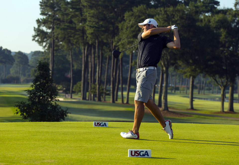 Photo - In this photo released by the USGA, Corey Conners, of Canada, watches his tee shot on the first hole during the semifinal round of match play at the U.S. Amateur Championship golf tournament at Atlanta Athletic Club in Johns Creek, Ga., Saturday, Aug. 16, 2014.  (AP Photo/USGA, Chris Keane)