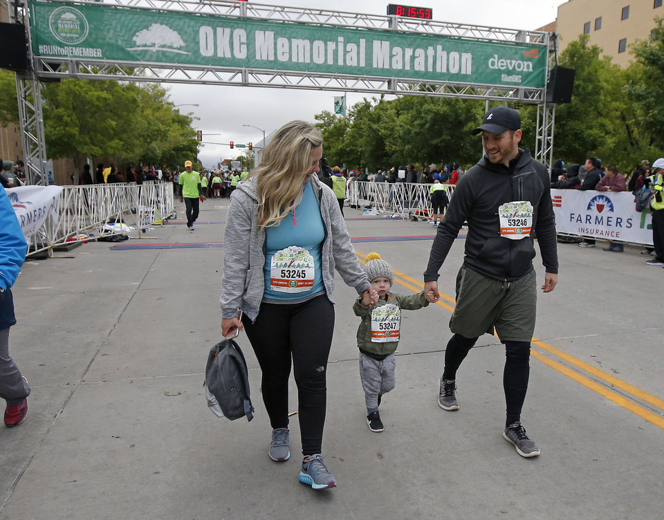 Photo - Royce and Keri Young walk with thier son Harrison, 2, during the children's marathon in the Oklahoma City Memorial Marathon in Oklahoma City, Sunday, April 30, 2017. Photo by Bryan Terry, The Oklahoman