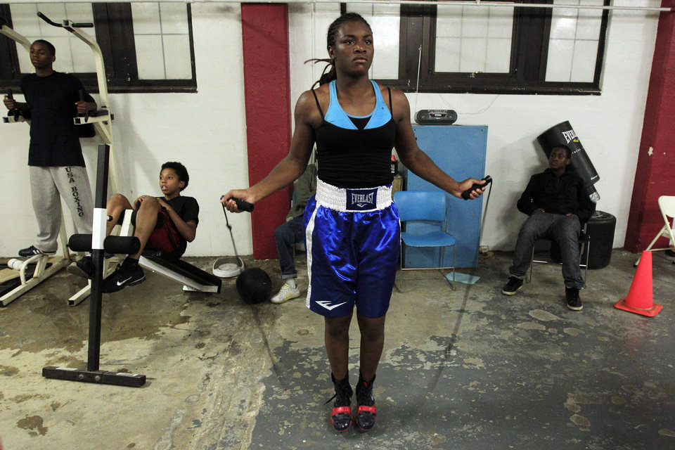 Photo -   In this Sept. 18, 2012, photo, Olympic gold medal boxer Claressa Shields skips rope at the Berston Field House in Flint, Mich. Shields is a fearsome presence in the ring. Her scowl and angry stare are the first signs of the trouble that awaits her opponents. (AP Photo/Carlos Osorio)