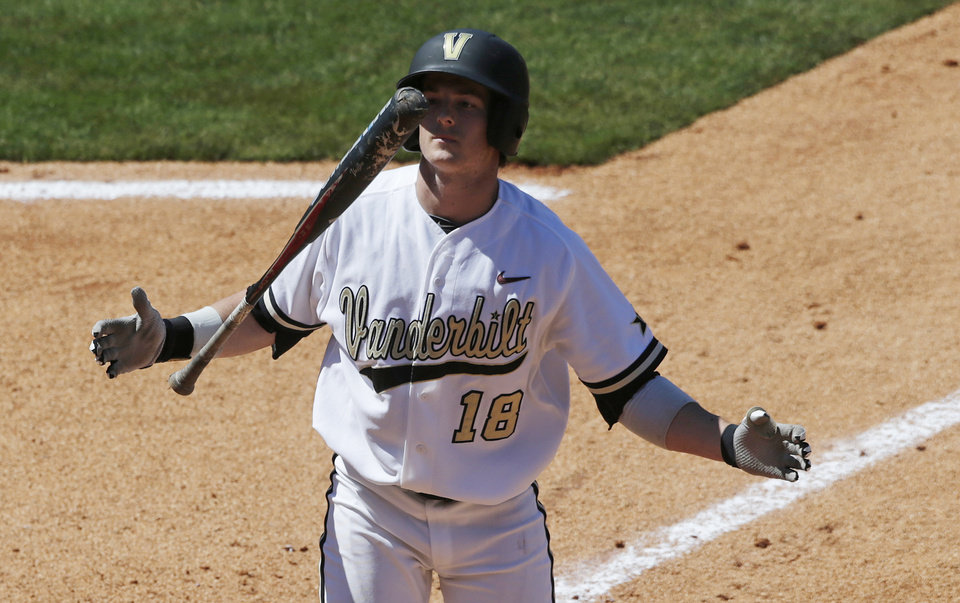 Photo - Vanderbilt's Mike Yastrzemski reacts after striking out to end the fifth inning of their Southeastern Conference Tournament NCAA college baseball game against South Carolina at the Hoover Met in Hoover, Ala., Thursday, May 23, 2013. (AP Photo/Dave Martin)