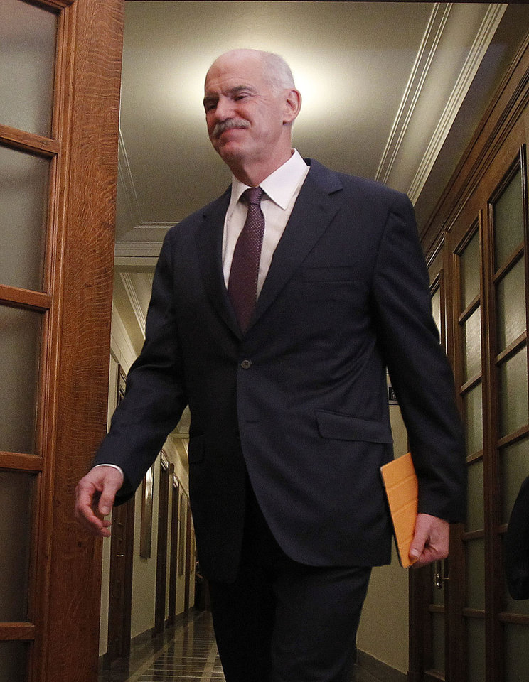 Greek Prime Minister George Papandreou arrives at a cabinet meeting in the Greek parliament in Athens, Tuesday, Nov. 1, 2011. Lawmakers in Greece's ruling Socialist party revolted Tuesday over their prime minister's surprise decision to hold a referendum on a European debt deal, threatening the very survival of his embattled government. (AP Photo/Thanassis Stavrakis) ORG XMIT: ATH113