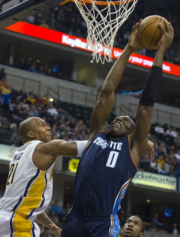Charlotte Bobcats' Bismack Biyombo (0) drives to the basket against Indiana Pacers' David West (21) during the first half of an NBA basketball game in Indianapolis, Saturday, Jan. 12, 2013. (AP Photo/Doug McSchooler)