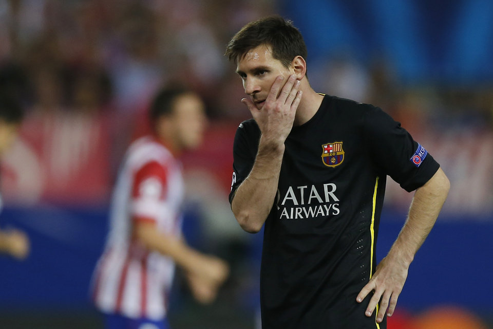 Photo - Barcelona's Lionel Messi from Argentina gestures during the Champions League quarterfinal second leg soccer match between Atletico Madrid and FC Barcelona at the Vicente Calderon stadium in Madrid, Spain, Wednesday, April 9, 2014. (AP Photo/Andres Kudacki)