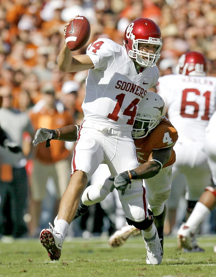 Photo - Aaron Williams of Texas sacks OU's  Sam Bradford during the Red River Rivalry college football game between the University of Oklahoma Sooners (OU) and the University of Texas Longhorns (UT) at the Cotton Bowl in Dallas, Texas, Saturday, Oct. 17, 2009. Photo by Bryan Terry, The Oklahoman