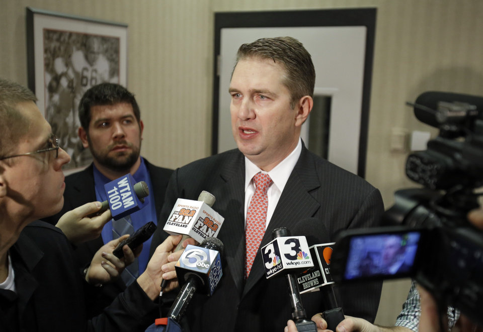 Photo - Cleveland Browns coach Rob Chudzinski talks with reporters after a news conference announcing the hiring of Mike Lombardi as vice president of player personnel at the NFL football team's practice facility in Berea, Ohio Friday, Jan. 18, 2013. (AP Photo/Mark Duncan)