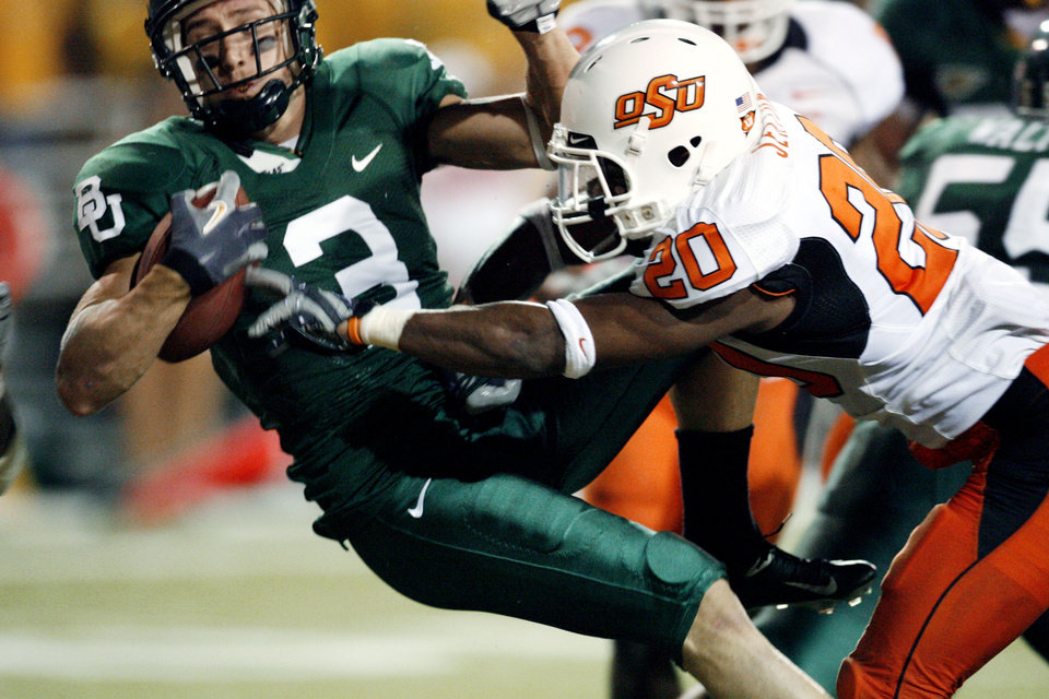 Baylor\'s Thomas White scores past Andre Sexton (20) during first half action in the college football game between Oklahoma State University and Baylor University at Floyd Casey Stadium in Waco, Texas, Saturday, Nov. 17, 2007. BY STEVE SISNEY, THE OKLAHOMAN