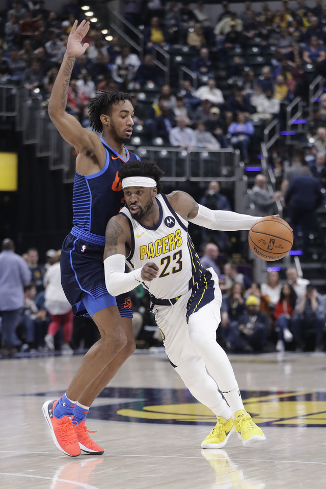Photo - Indiana Pacers' Wesley Matthews (23) goes to the basket against Oklahoma City Thunder's Terrance Ferguson (23) during the second half of an NBA basketball game, Thursday, March 14, 2019, in Indianapolis. Indiana won 108-106. (AP Photo/Darron Cummings)