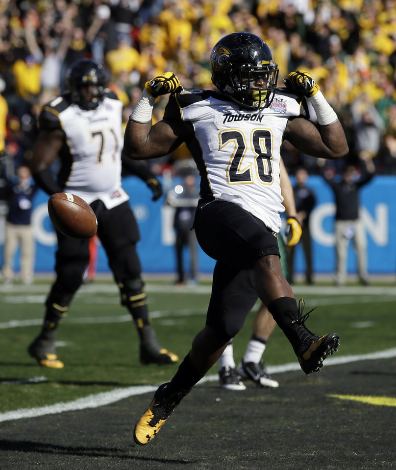 Photo - Towson running back Terrance West (28) celebrates his touchdown run against North Dakota State in the first half of the FCS championship NCAA college football game, Saturday, Jan. 4, 2014, in Frisco, Texas. (AP Photo/Tony Gutierrez)
