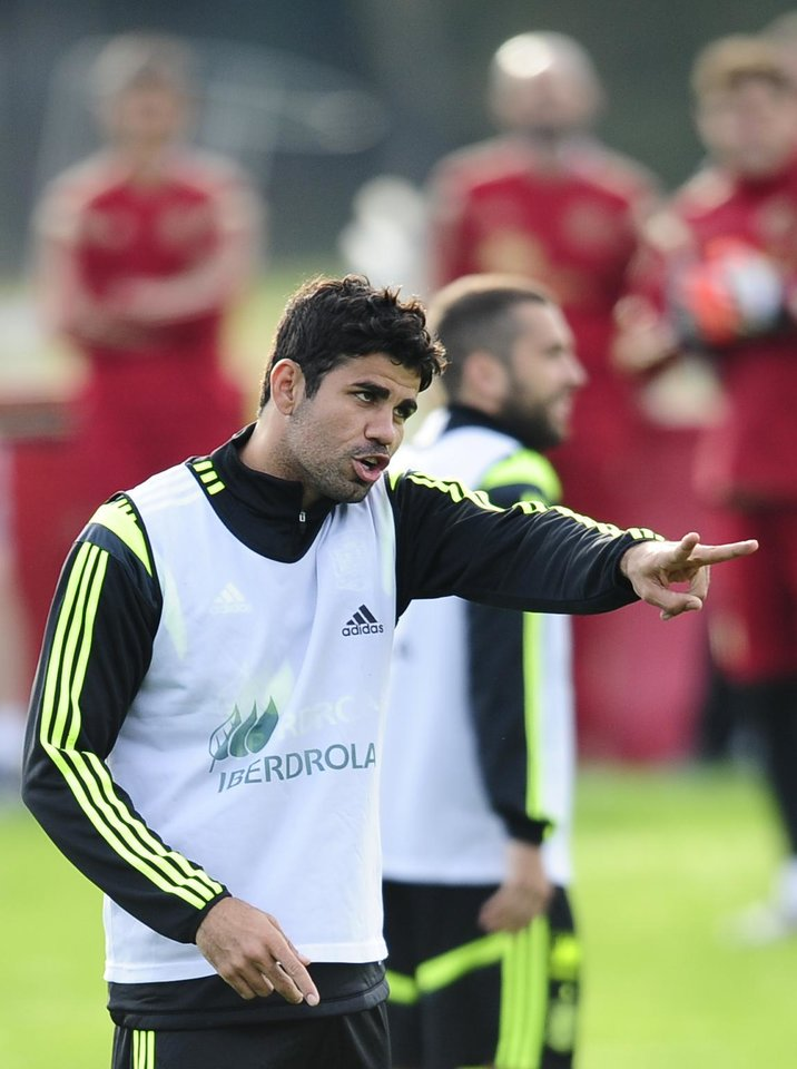 Photo - Spain's Diego Costa gestures during a training session at the Atletico Paranaense training center in Curitiba, Brazil, Monday, June 9, 2014. Spain will play in group B of the Brazil 2014 World Cup. (AP Photo/Manu Fernandez)