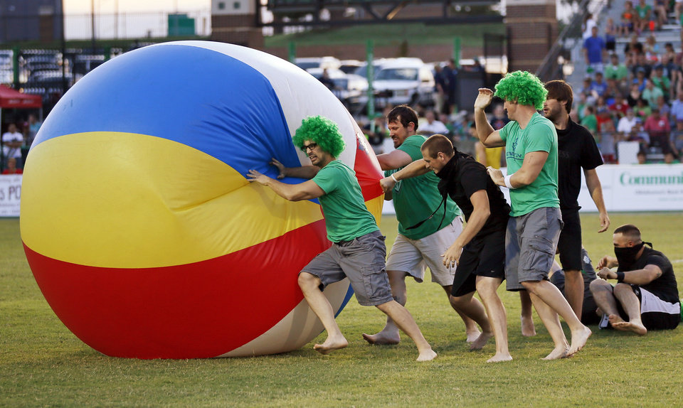 Photo - Fans play with a giant beach ball at halftime during a soccer game between the OKC Energy FC and LA Galaxy II at Pribil Stadium at Bishop McGuinness Catholic High School in Oklahoma City, Saturday, Aug. 16, 2014. Photo by Nate Billings, The Oklahoman