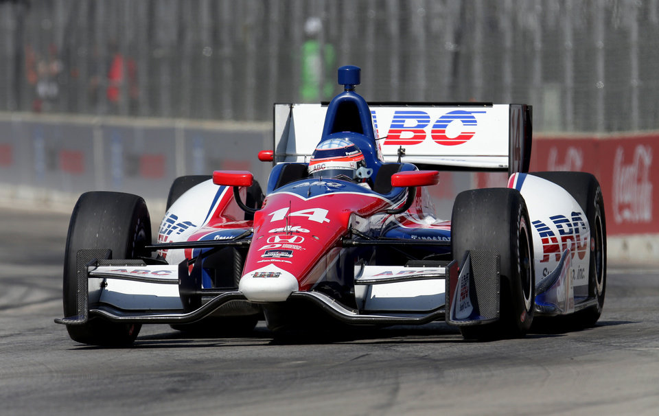 Photo - Takuma Sato, of Japan, qualifies for the second race of the IndyCar Detroit Grand Prix auto racing doubleheader in Detroit, Sunday, June 1, 2014. Sato won the pole for the second race. (AP Photo/Dave Frechette)