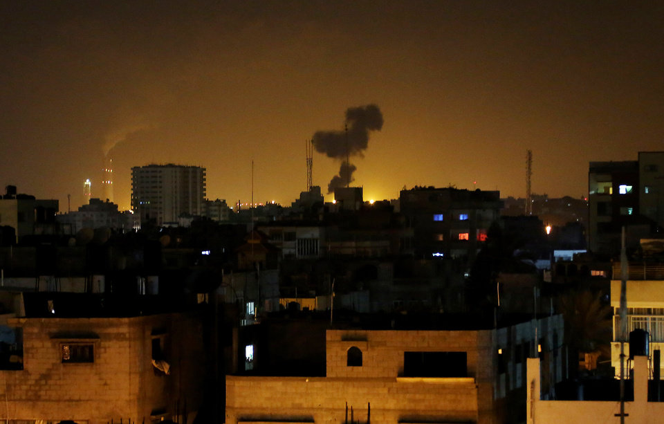 Photo - Smoke rises after an Israeli missile strike in Beit Lahia, northern Gaza Strip, early Monday, July 7, 2014.  The Islamic militant group Hamas that rules Gaza vowed revenge on Israel for the death of seven of its members killed in an airstrike early Monday morning in the deadliest exchange of fire since the latest round of attacks began weeks ago. (AP Photo/Hatem Moussa)