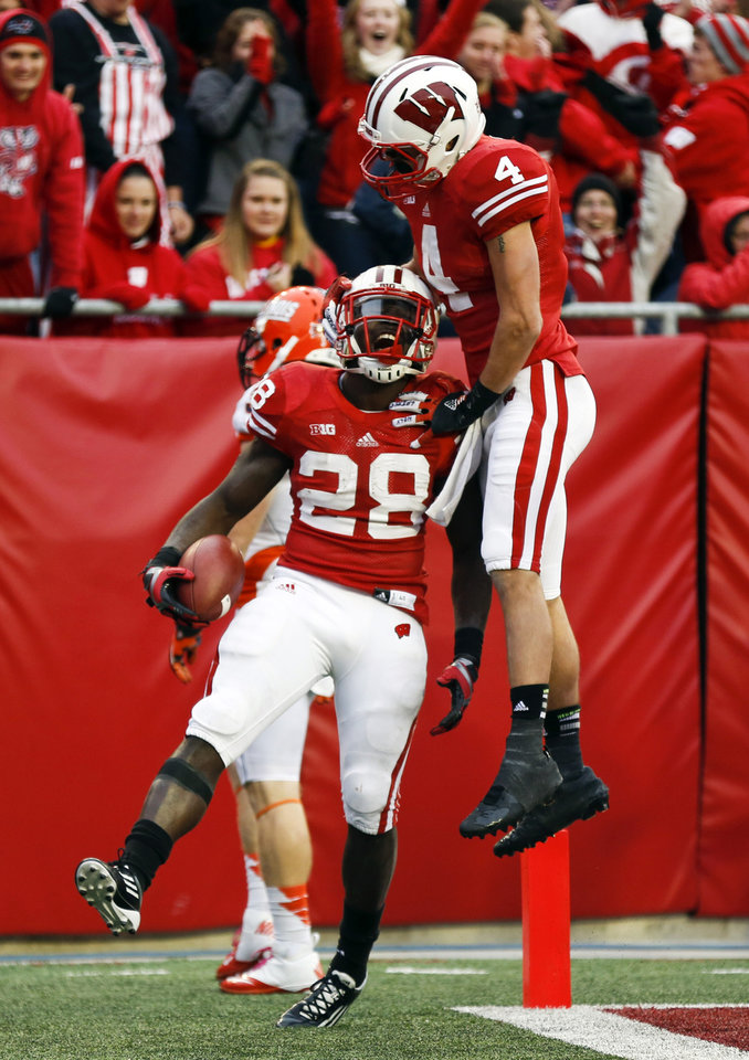Photo -   Wisconsin's Jared Abbrederis (4) jumps on teammate Montee Ball (28) after Ball's touchdown run during the second half of an NCAA college football game against Illinois, Saturday, Oct. 6, 2012, in Madison, Wis. (AP Photo/Andy Manis)