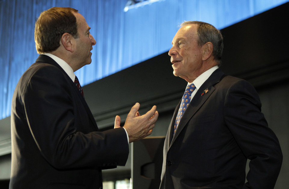 Photo -   National Hockey League Commissioner Gary Bettman, left, chats with New York Mayor Michael Bloomberg following a press conference, Wednesday, Oct. 24, 2012 in New York, announcing that the New York Islanders will move from Nassau Veterans Memorial Coliseum in Uniondale, N.Y., and play at Brooklyn's Barclays Center starting in 2015. (AP Photo/Kathy Willens)