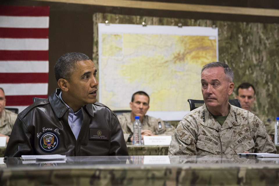 Photo - President Barack Obama, left, speaks during a briefing by Marine General Joseph Dunford, commander of the US-led International Security Assistance Force (ISAF), after arriving at Bagram Air Field for an unannounced visit, on Sunday, May 25, 2014, north of Kabul, Afghanistan. (AP Photo/ Evan Vucci)