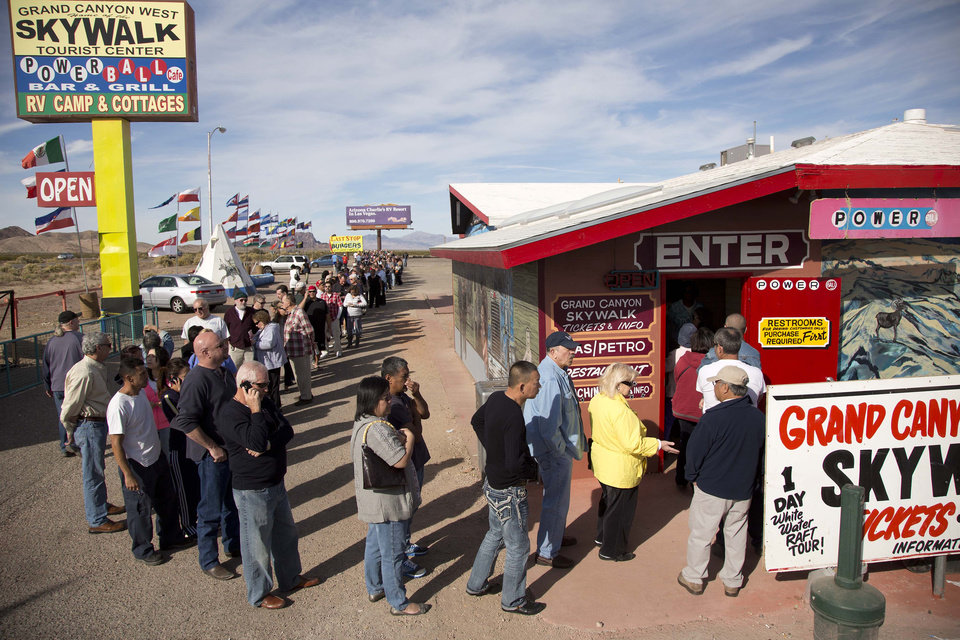 Photo -   A crowd of people line up outside the Arizona Last Stop convenience store and souvenir shop to buy Powerball tickets, Tuesday, Nov. 27, 2012, in White Hills, Ariz. There has been no Powerball winner since Oct. 6, and the jackpot already has reached a record level for the game. Already over $500 million, it is the second-highest jackpot in lottery history, behind only the $656 million Mega Millions prize in March. (AP Photo/Julie Jacobson)