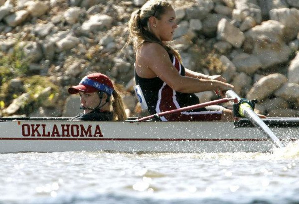 Photo - University of Oklahoma Coxswain, Carly Schueler (left) and teammate Abbie Seremek (right) compete in the Womens Open 4+ during the 2011 Head of the Oklahoma Regatta at the Oklahoma River in Oklahoma City on Sunday, October 2, 2011. Photo by John Clanton, The Oklahoman ORG XMIT: KOD  JOHN CLANTON - John Clanton