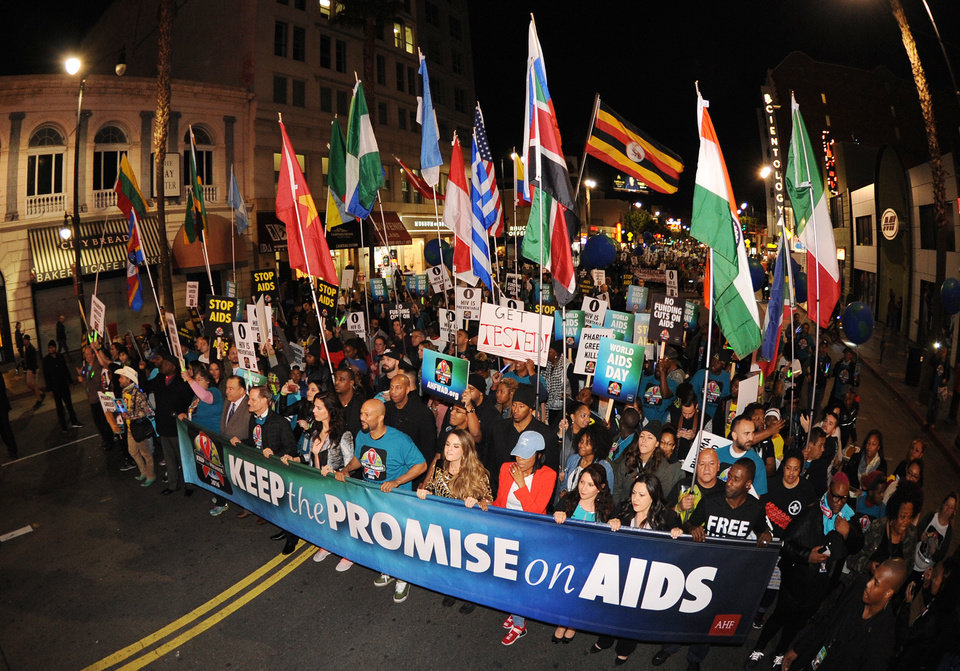 Photo - IMAGE DISTRIBUTED FOR AIDS HEALTHCARE FOUNDATION - More than a thousand advocates, including entertainers Common, JoJo, Rosie Perez, and others, take part in AIDS Healthcare Foundation's 'Keep the Promise' March in Hollywood, CA on Nov. 30, 2016. The march took place down historic Hollywood Boulevard on the eve of World AIDS Day to raise awareness about HIV/AIDS and to persuade key decision makers in the US and around the globe to 'keep the promise' and commit more funds to HIV/AIDS prevention, care and treatment. A free Keep the Promise concert at the Dolby Theatre headlined by Patti LaBelle and Common and honoring legendary entertainer and humanitarian Harry Belafonte for his charitable work followed the march.(Carlos Delgado/AP Images for AIDS Healthcare Foundation)