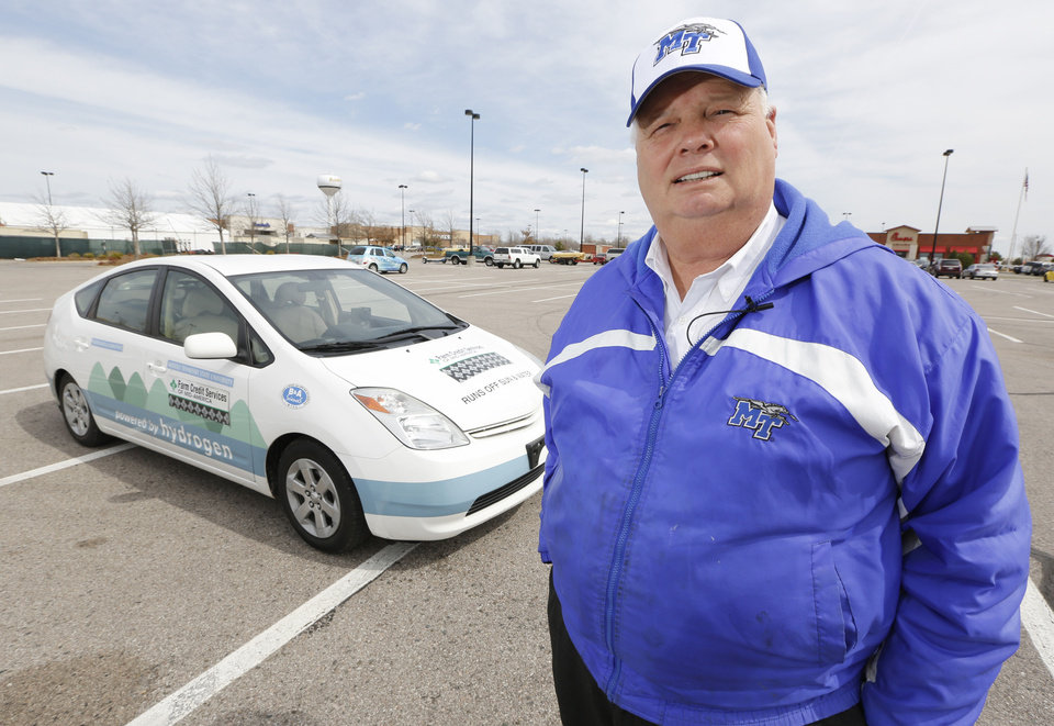 Photo - Middle Tennessee State University professor Cliff Ricketts is driving from Georgia to California in a car powered by hydrogen rather than gasoline. He stopped in Midwest City on Tuesday in this modified 2005 Toyota Prius. Photo by Steve Gooch, The Oklahoman
