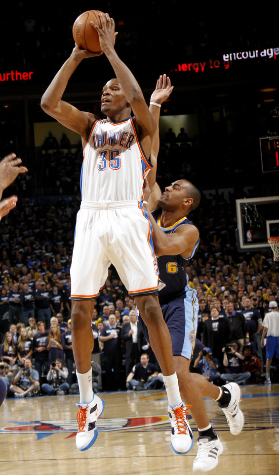 Oklahoma City's Kevin Durant (35) shoots as Denver's Arron Afflalo (6) defends during the NBA basketball game between the Denver Nuggets and the Oklahoma City Thunder in the first round of the NBA playoffs at the Oklahoma City Arena, Wednesday, April 27, 2011. Photo by Bryan Terry, The Oklahoman