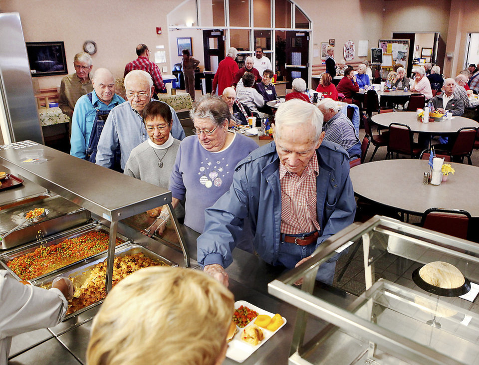 Photo - About 70 people eat their lunch five days a week at Midwest City Senior Center. PHOTO BY JIM BECKEL, THE OKLAHOMAN