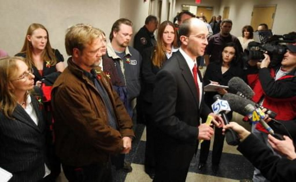 District Attorney Greg Mashburn talks with the media surrounded by the family of  Jamie Rose Bolin following a trial where Kevin Ray Underwood was sentenced to death in Norman in this March 7, 2008 photo by Steve Sisney. A defense attorney for Underwood today argued for a new trial in the case.